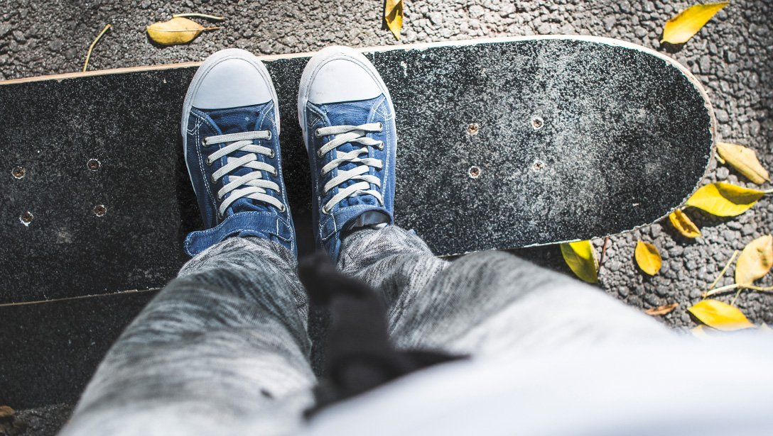 blue shoes and skateboard in autumn